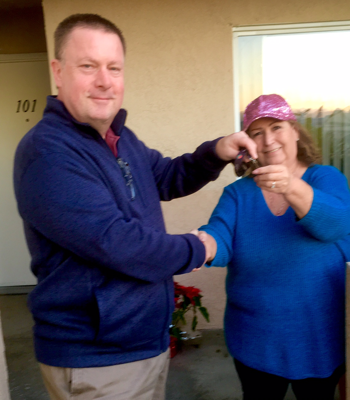 chris gallatin hands keys to new townhouse owner