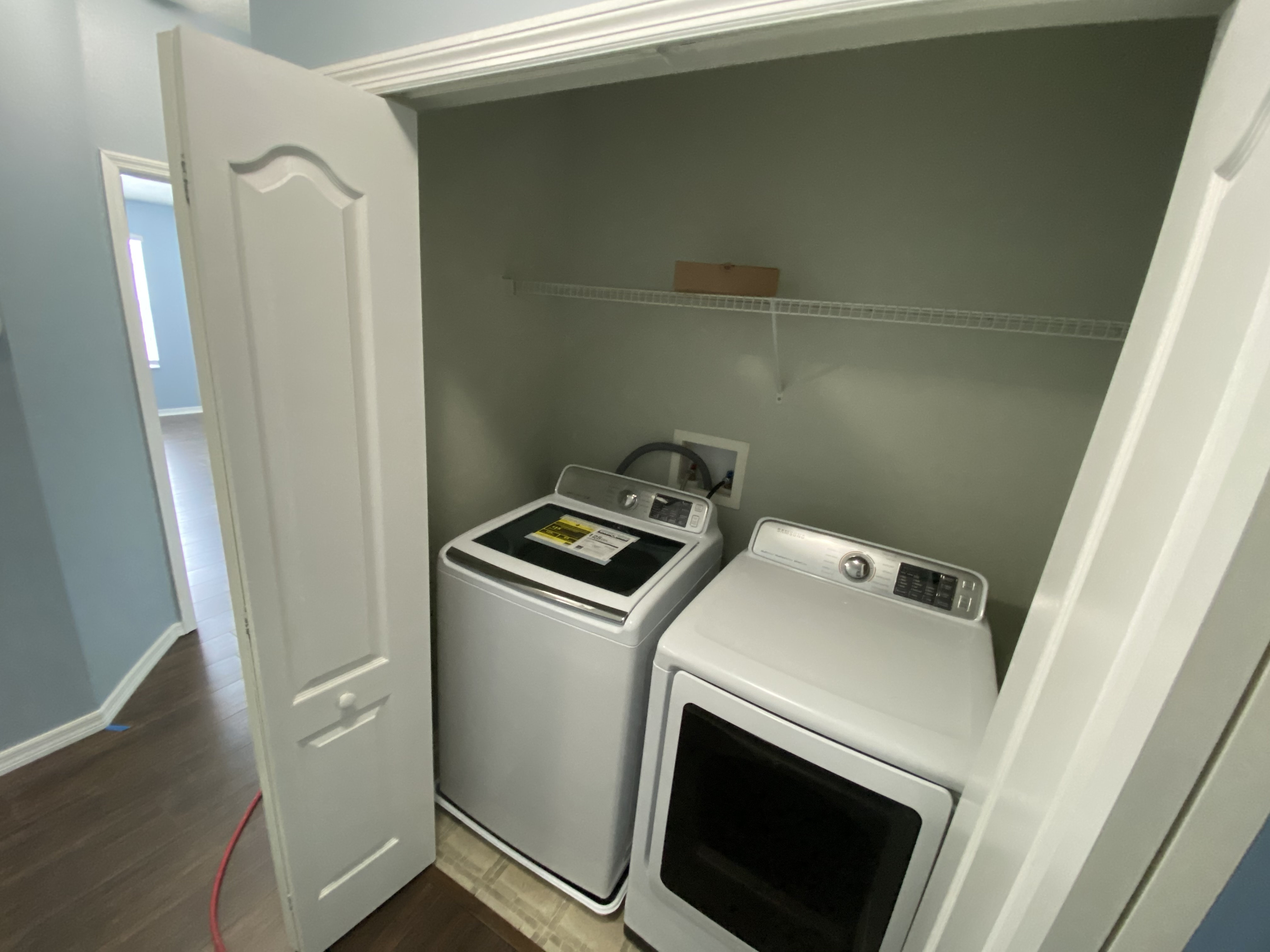Laundry Area with New Washer and Dryer