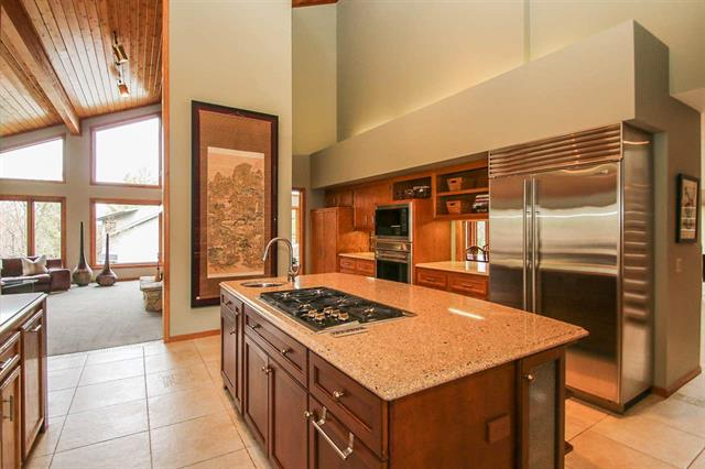 Cook's dream. Spacious open kitchen features a soaring knotty-pine wood ceiling.