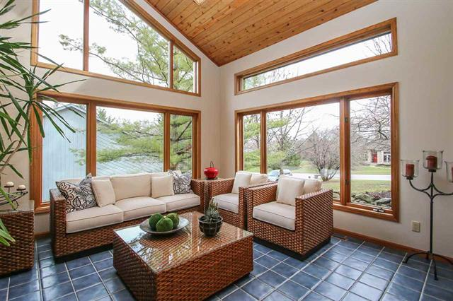 4-season sunroom with one wall of natural stone.