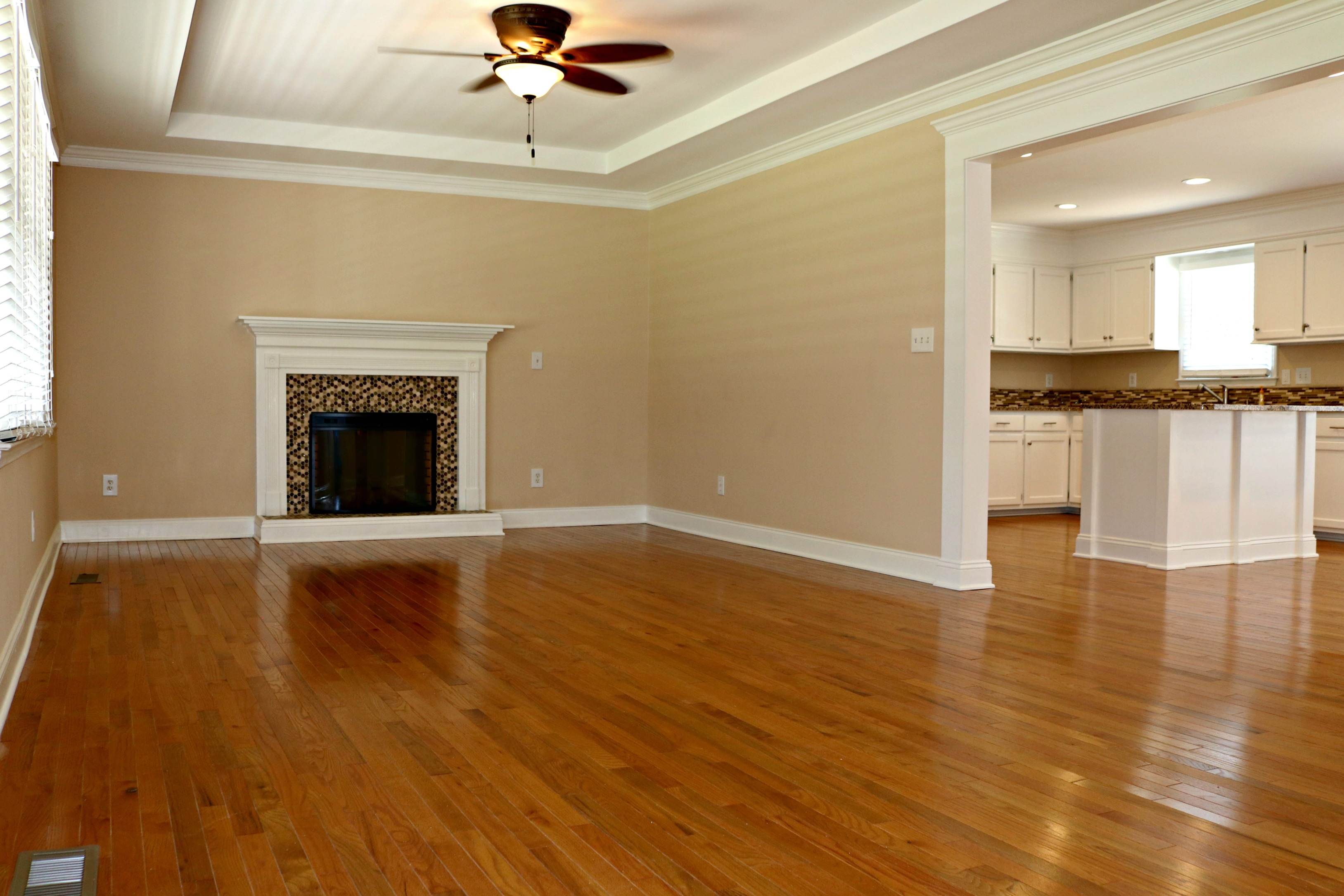Your New Home Features An Open Floor Plan With GORGEOUS Hardwood Flooring Throughout The Living Room Kitchen Dining Hallway And Master Suite
