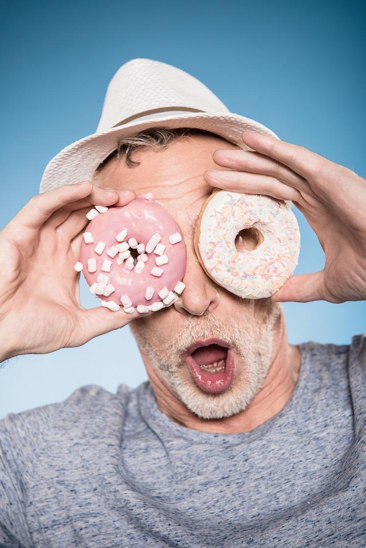 Senior Having Donut Fun