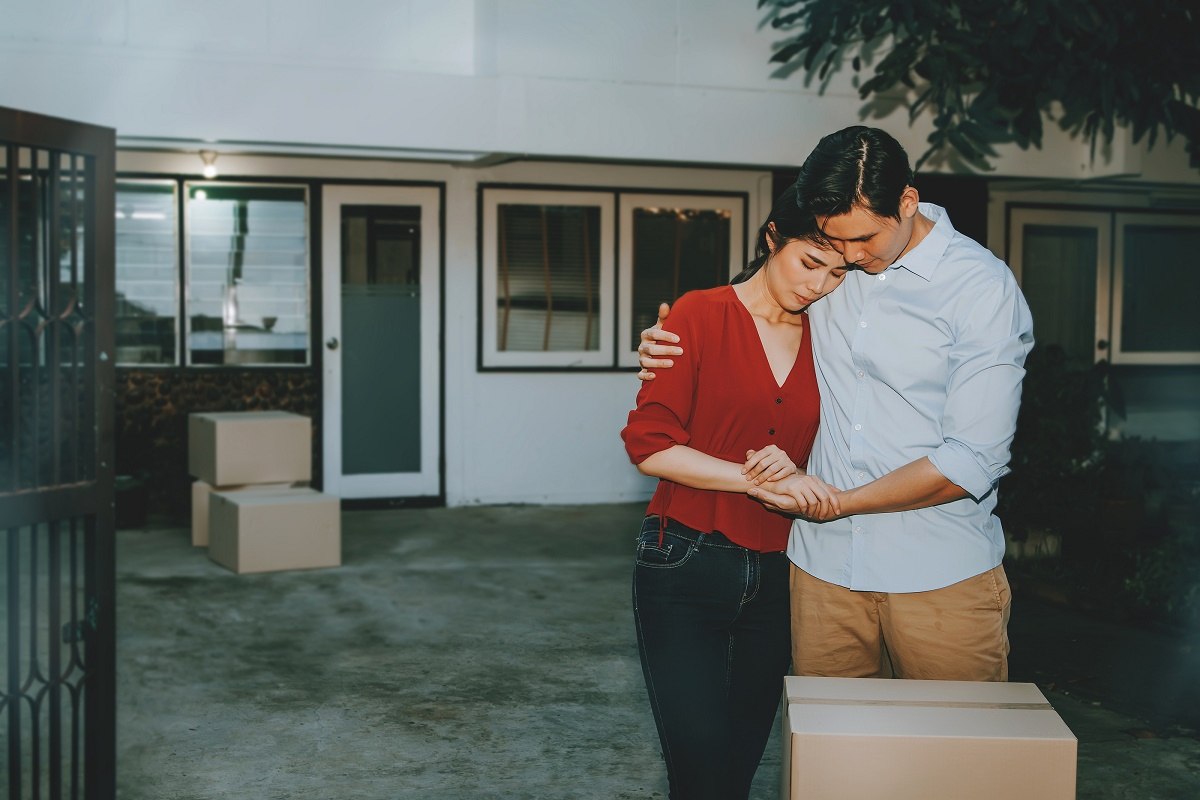 Couple Leaving Their Old Home Sad