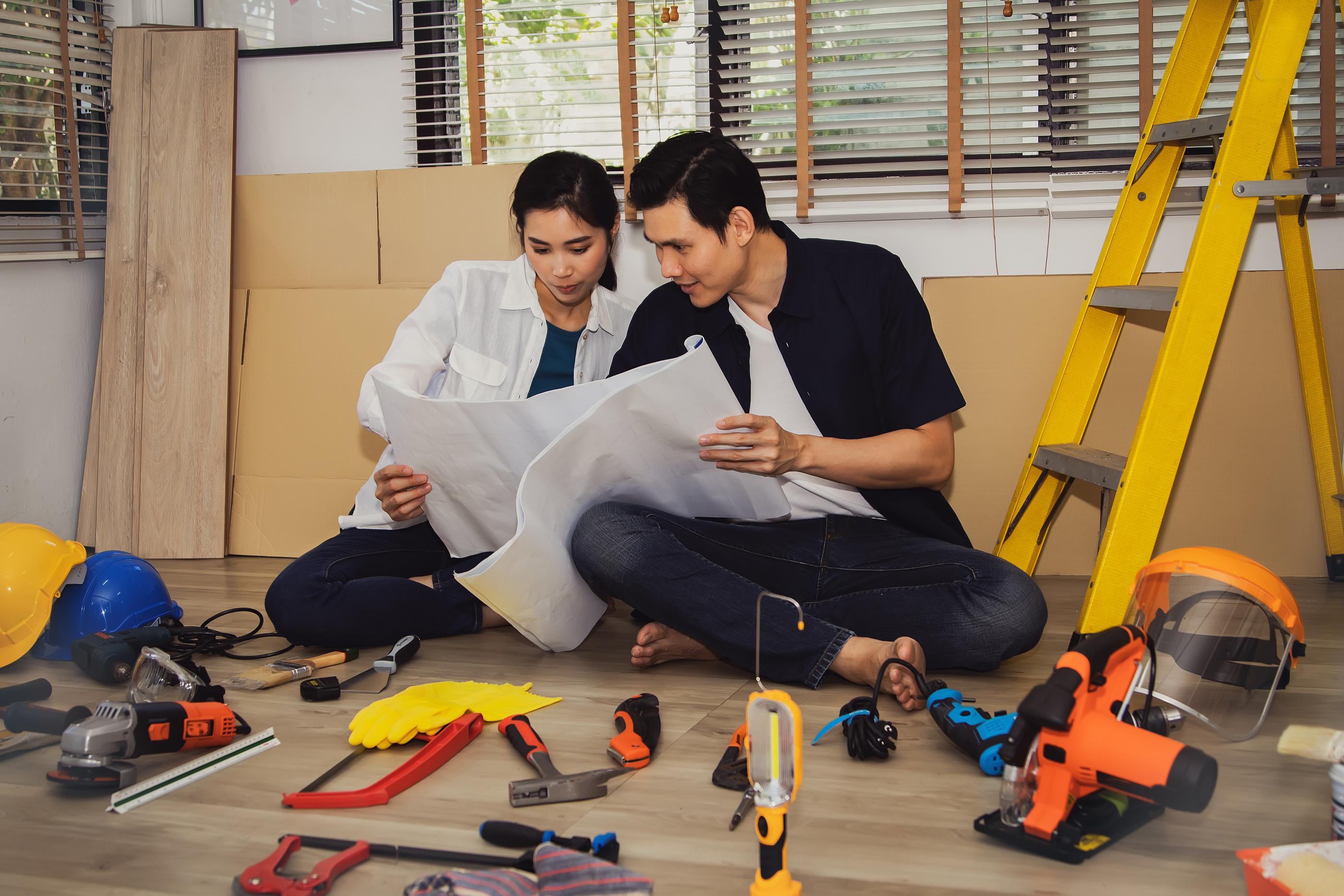 couple looking at repair guide