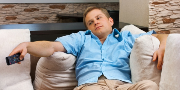 Bored sports fan watching tv