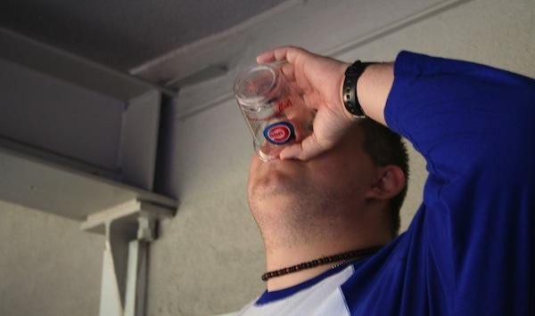 Cubs fan drinking beer