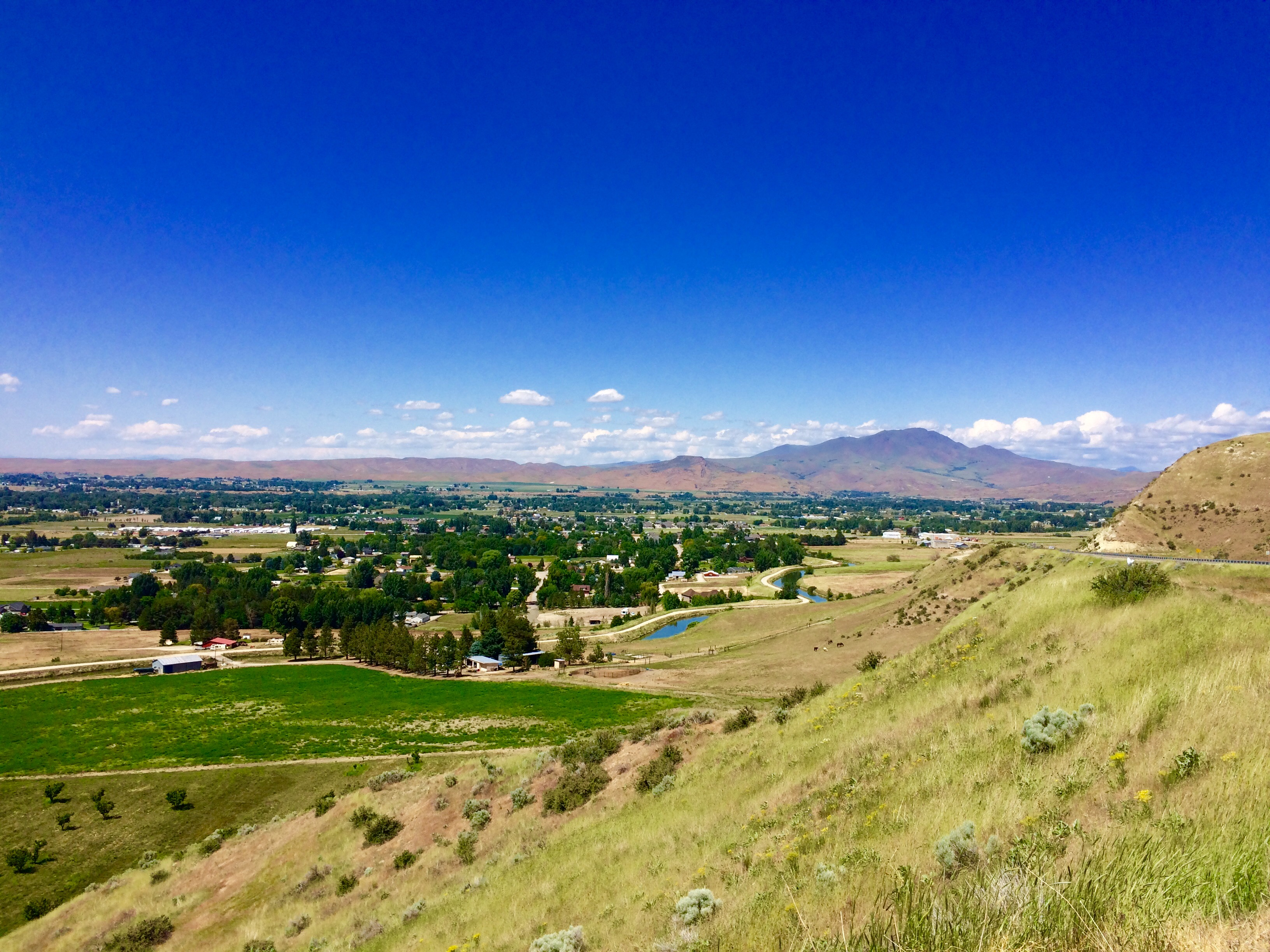 Overlooking Emmett from Freeze Out Hill. The prominent Squaw Butte among  the clouds.