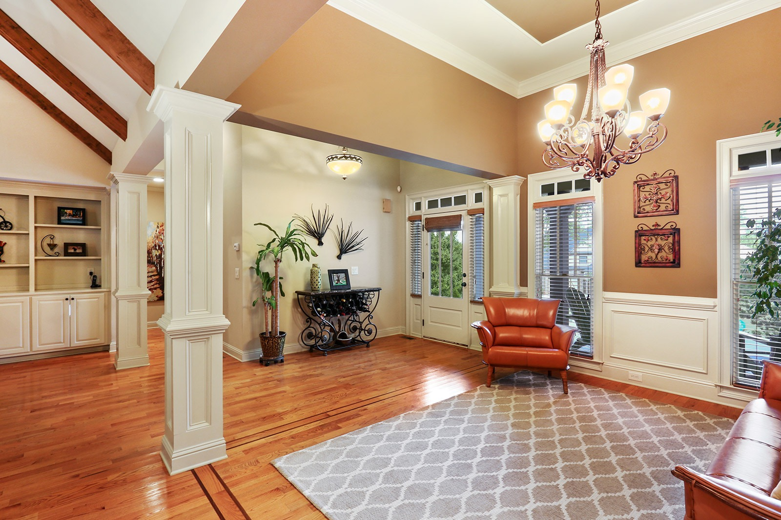 quality craftsman home in woodstock the formal dining room has columns extensive molding and trim and a beautiful chandelier the front door has custom sun tinted windows for privacy