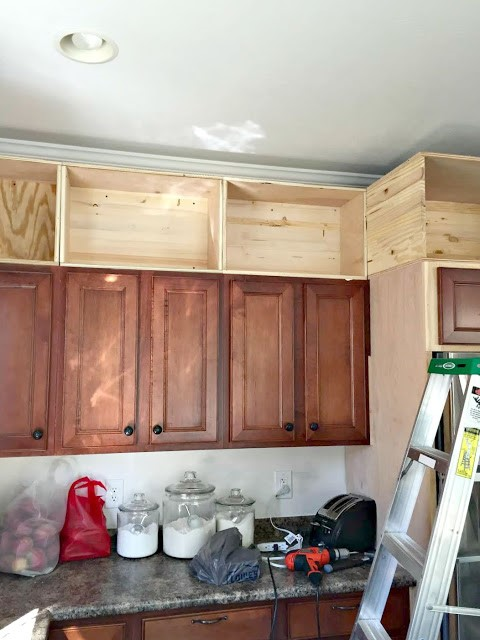 build cabinet boxes above the existing cabinets that line up with the existing cabinet boxes below them  u2013 and mount them to the wall studs directly above     upgrading your kitchen cabinets without buying new ones  rh   teamhursthouses com