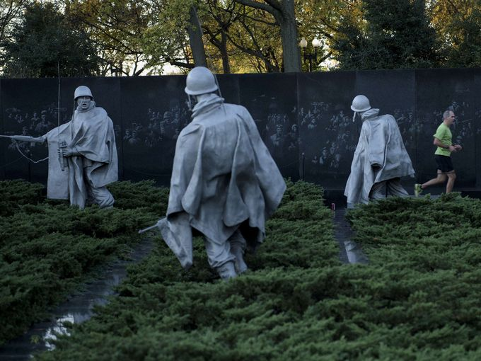 USA Today Photo gallery - A man runs past the Korean War Memorial on the National Mall on Veterans Day in Washington, DC.  Brendan Smialowski, AFP/Getty Images