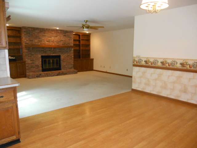 Family Room with Fireplace open to Kitchen