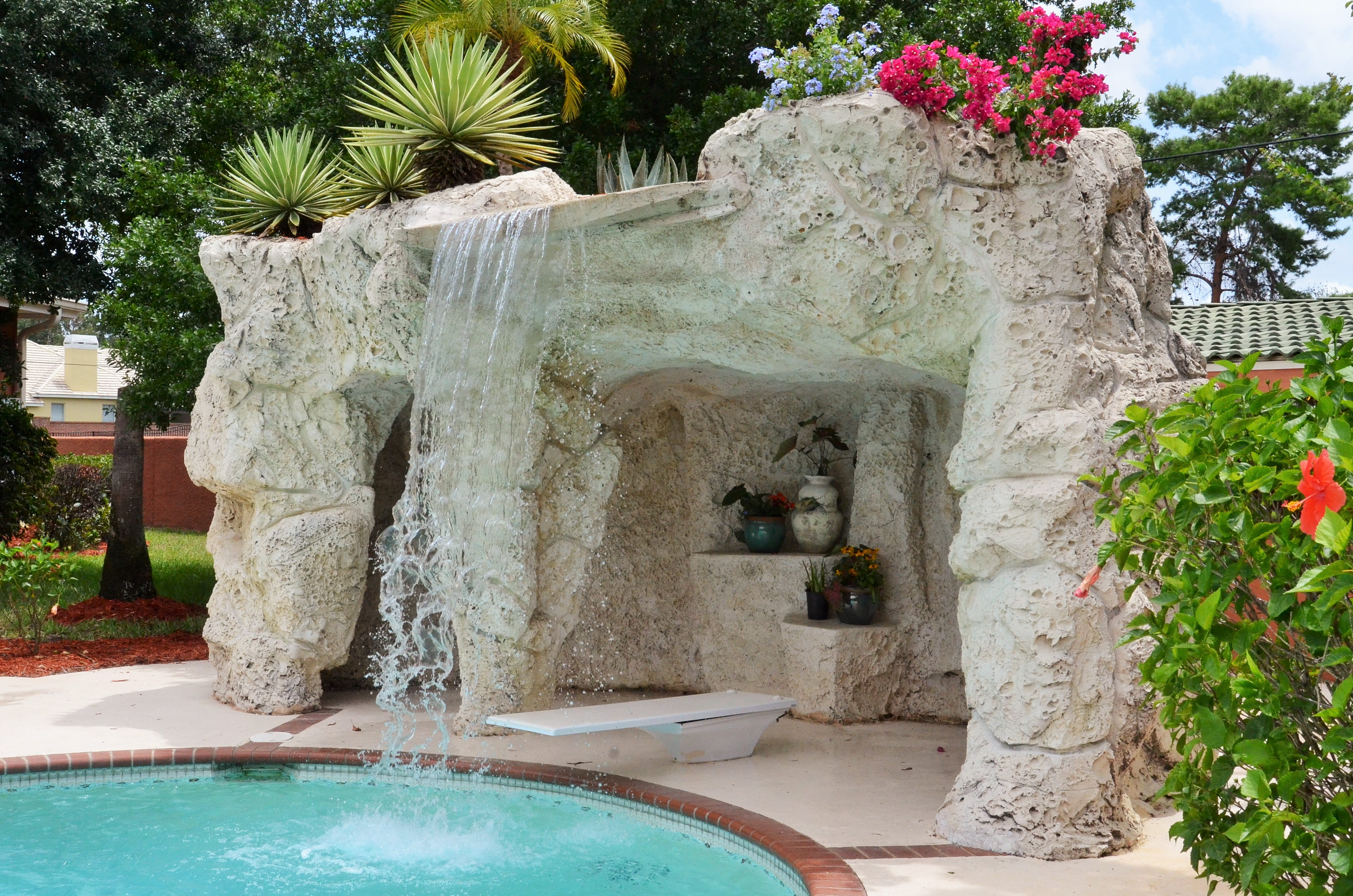 Cascading Waterfall into Pool Oasis