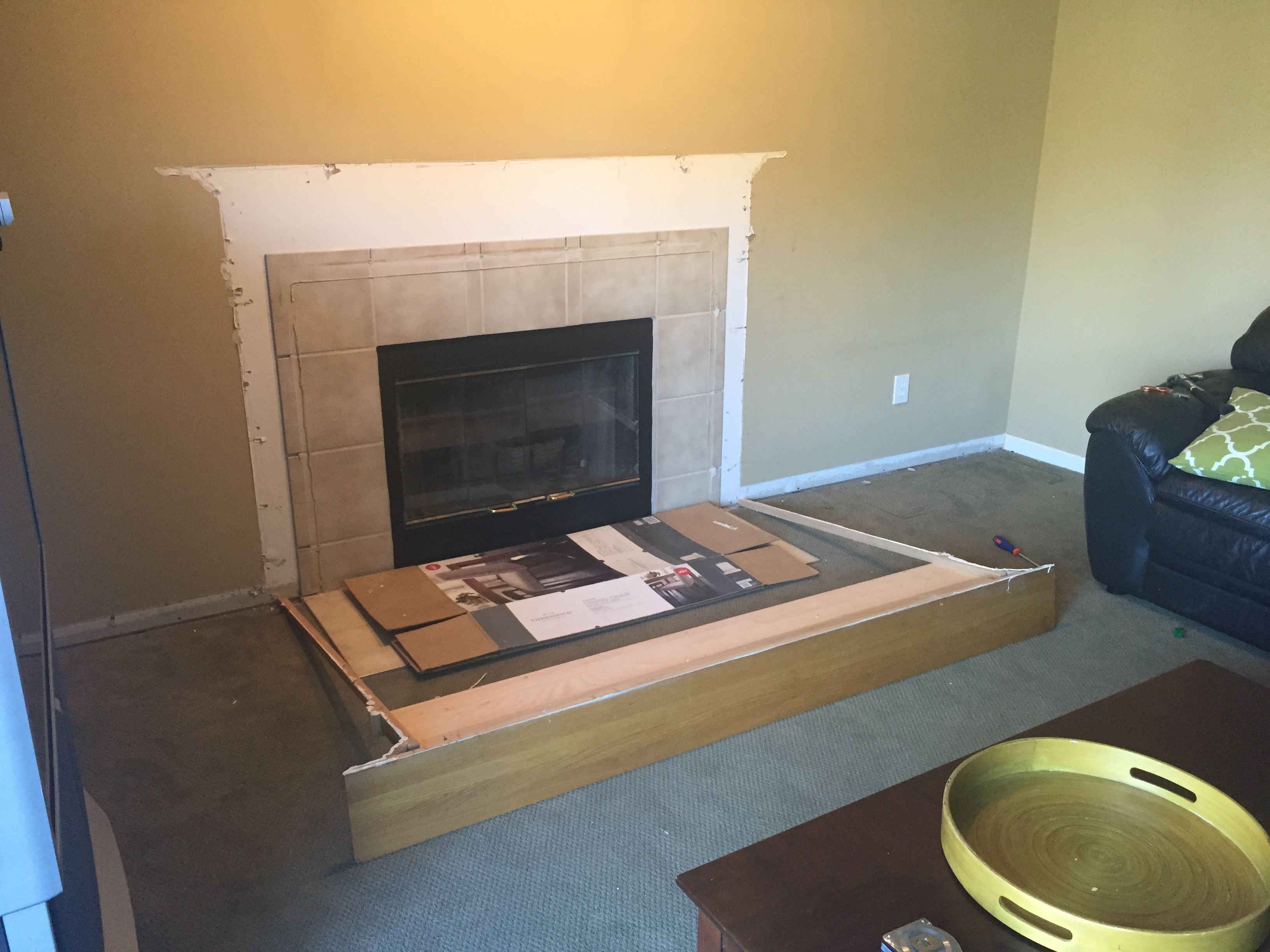 Next, I brought the 4 base cabinets in, placed 2 of them on each side of  the fireplace and worked out the measurements. I won't get into that here.