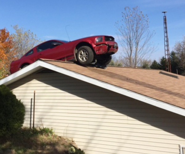 Car on top of house