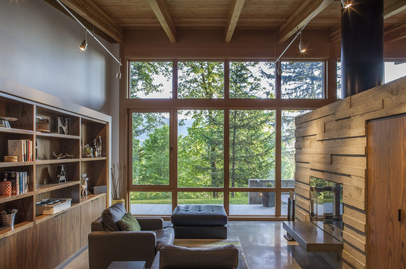 In Form This Cabin Is A Simple Bar Of Cedar And Glass Running Along The Length An Old Logging Road Anchored Into Hillside Sweeping Concrete Wall