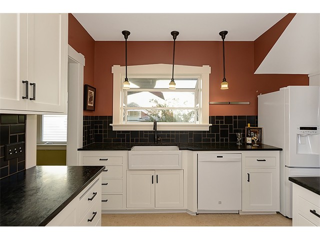 Beautifully Remodeled Kitchen with a Farmhouse Sink and Soapstone Countertops