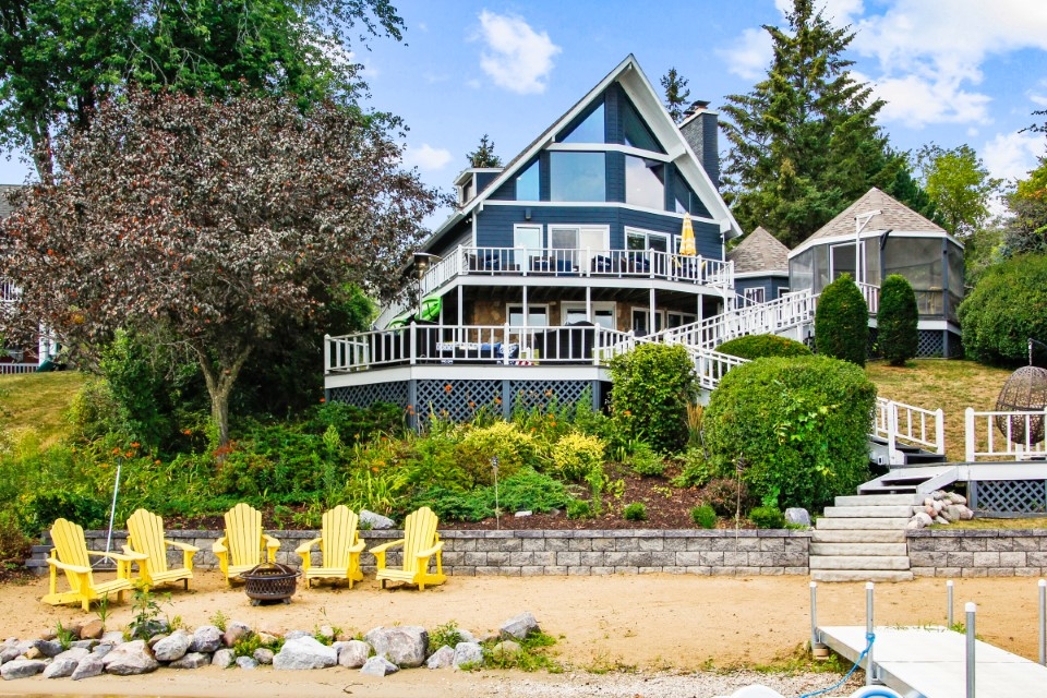 New Listing! 3BR, 3BA Chalet with 86′ Beach Frontage | N7370 Krahn Dr, Whitewater WI