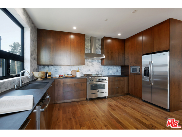 The Wood Cabinets Keep The Kitchen Warm And Inviting As Do The Wood Floors  Throughout The House. Decks, Balconies And The Yard Provide Indoor/outdoor  ...