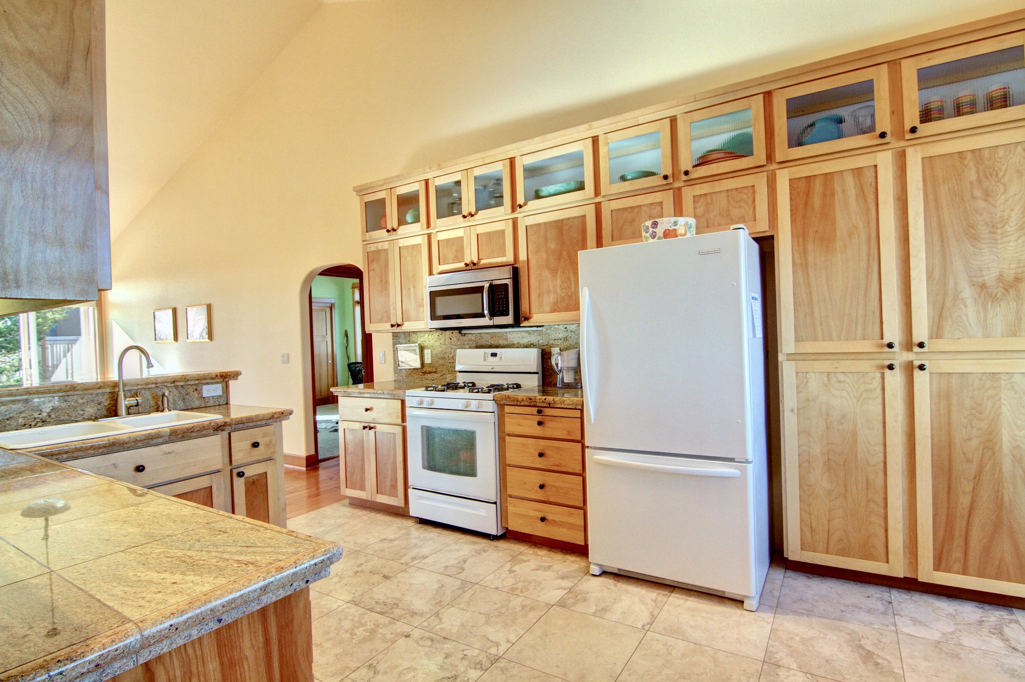 Spacious kitchen with beautiful custom cabinetry.