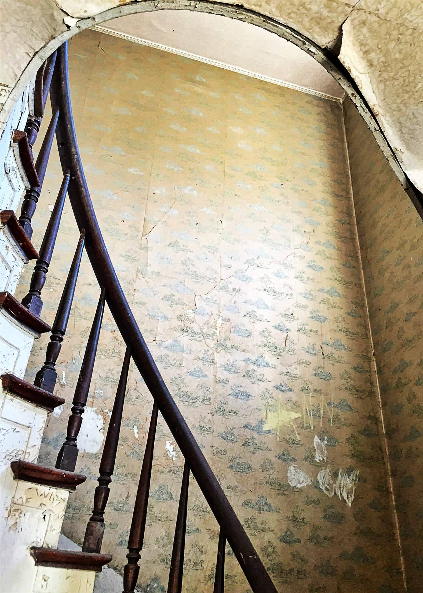 The Landmark pre-restoration: staircase and arch