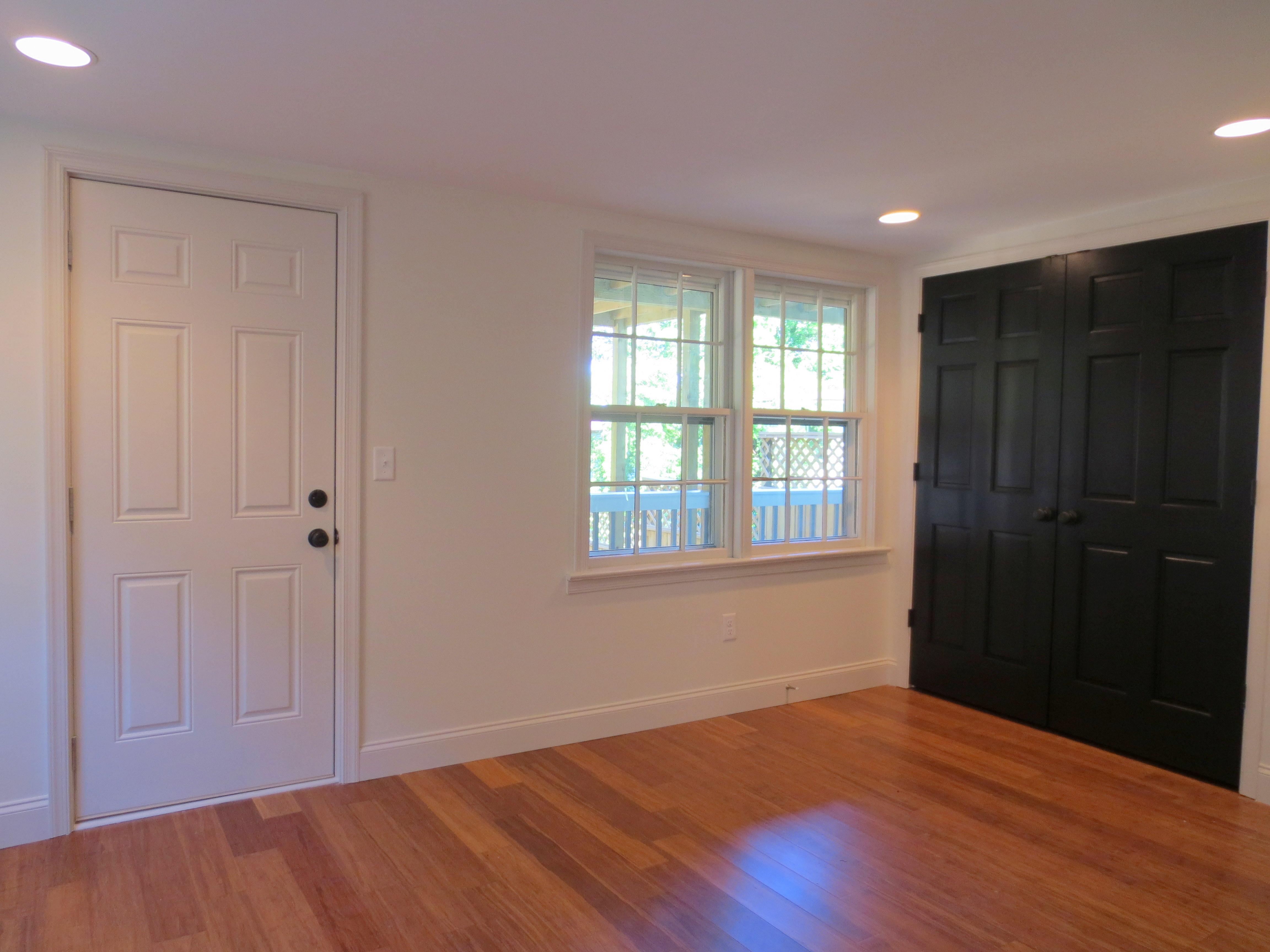The Landmark restored apartment bedroom leading to yard