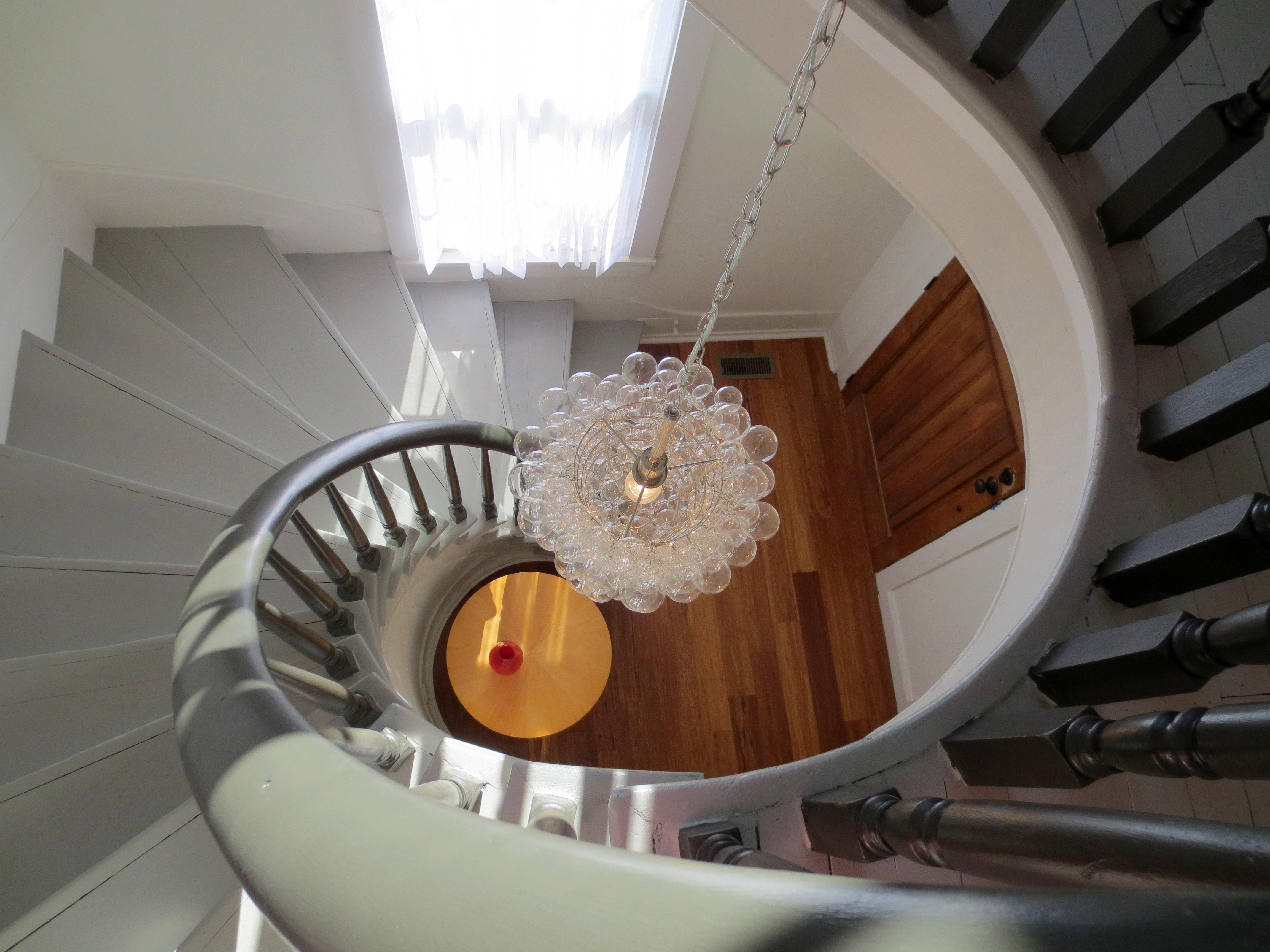The Landmark restored spiral stairway looking down