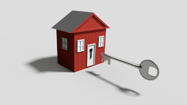 Cartoon of little red home and a big key about to unlock door