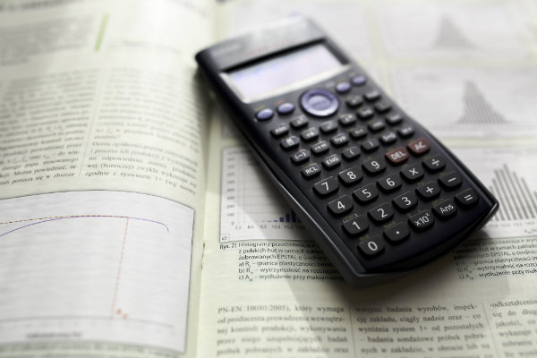 Calculator laying on top of a book