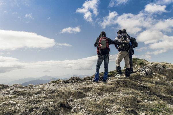 Mountain Climbers get to top of mountain