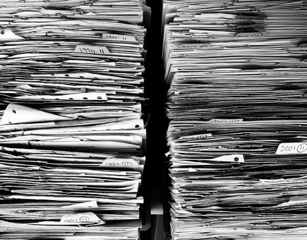 2 Piles of Old Paperwork