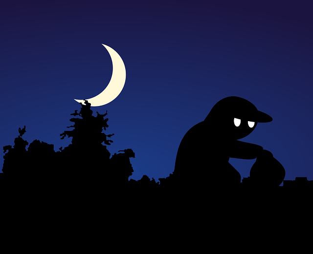 Thief in the night with moon in the background
