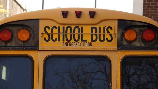 The back door of a big yellow school bus