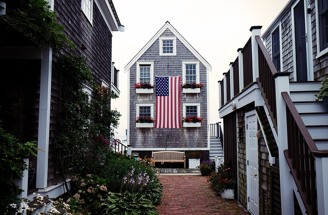 a House by the ocean in a cute neighborhood with an american flag in front