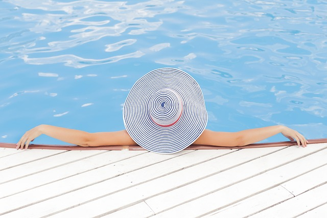 a woman sitting and relaxing by a pool