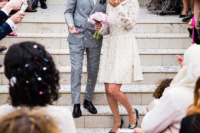 Two people walking down chapel stairs after getting married