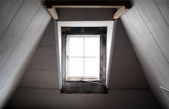 Image of an attic window brightening the room