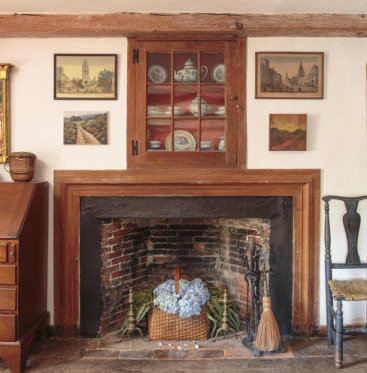An Image of an old historic fireplace in house in Cape Cod
