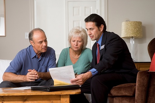 Financial Tips for Home Buyers - Agent with clients discussing finances.