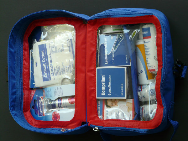 An opened emergency kit filled with tools and supplies